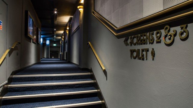 Interior wayfinding signage – cinema hallway