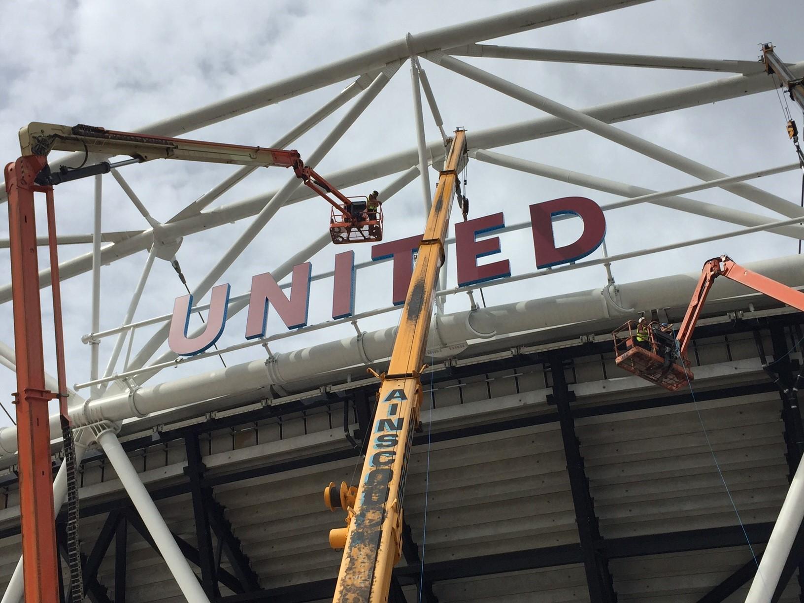 Commercial sign installation – Football stadium signage